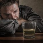 WHAT CAUSES ALCOHOL WITHDRAWAL SYMPTOMS?